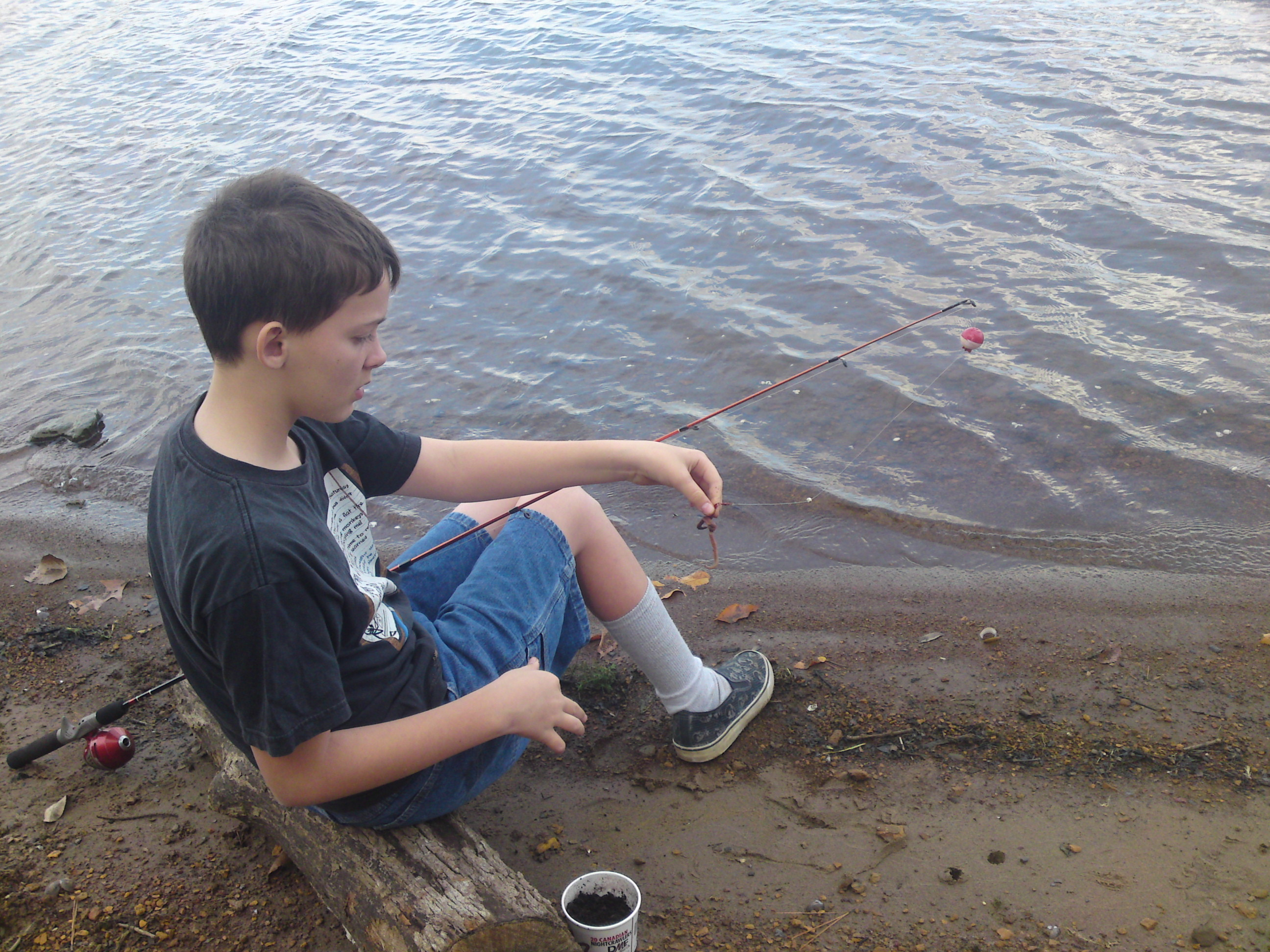 child fishing at a lake