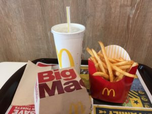 Picture of a meal at McDonald's, showing hamberger, fries and a drink.