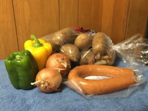 picture of groceries, potatoes, peppers, onions, and sausage